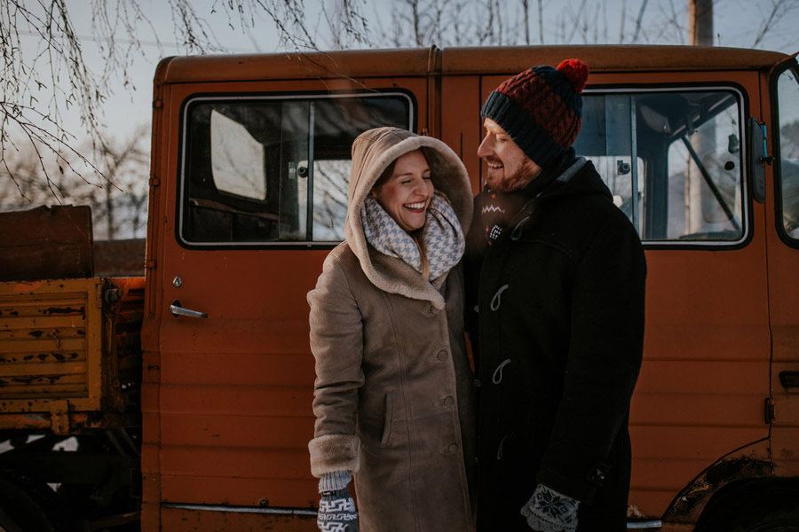 smiling couple with old truck