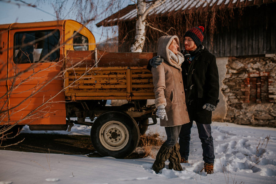 old orange truck and the couple