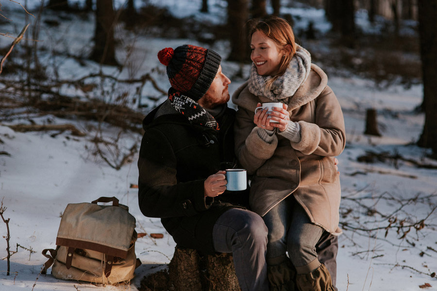 warming up drinking tea in the woods