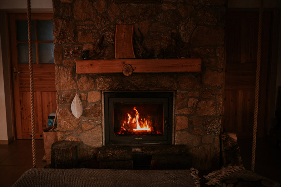 fireplace in wooden cabin
