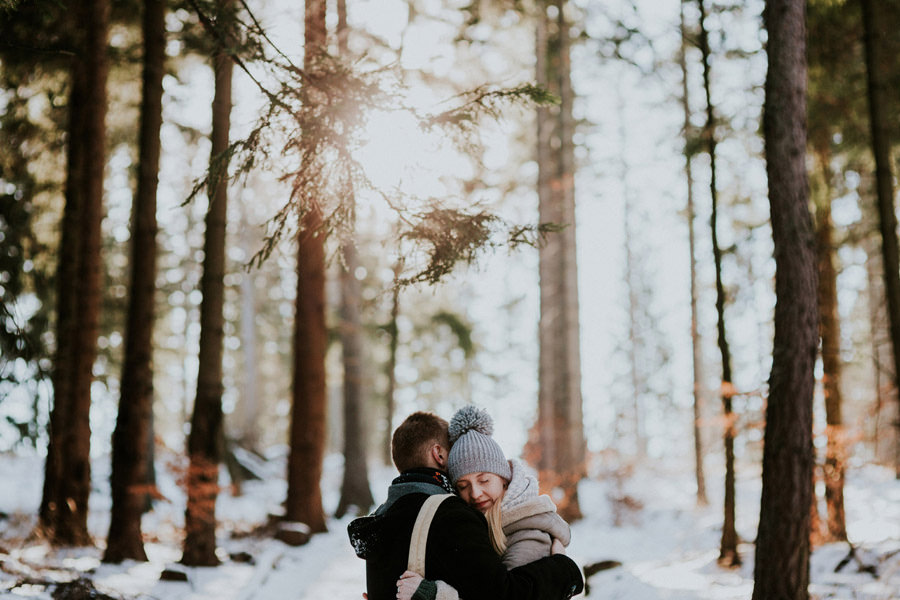 morning couple hug in the woods