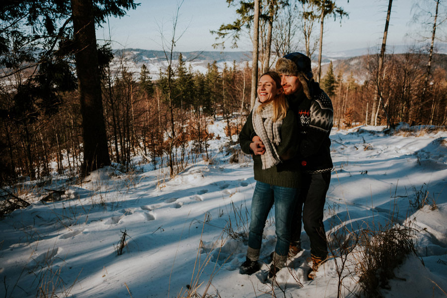 smiling in winter pine forest