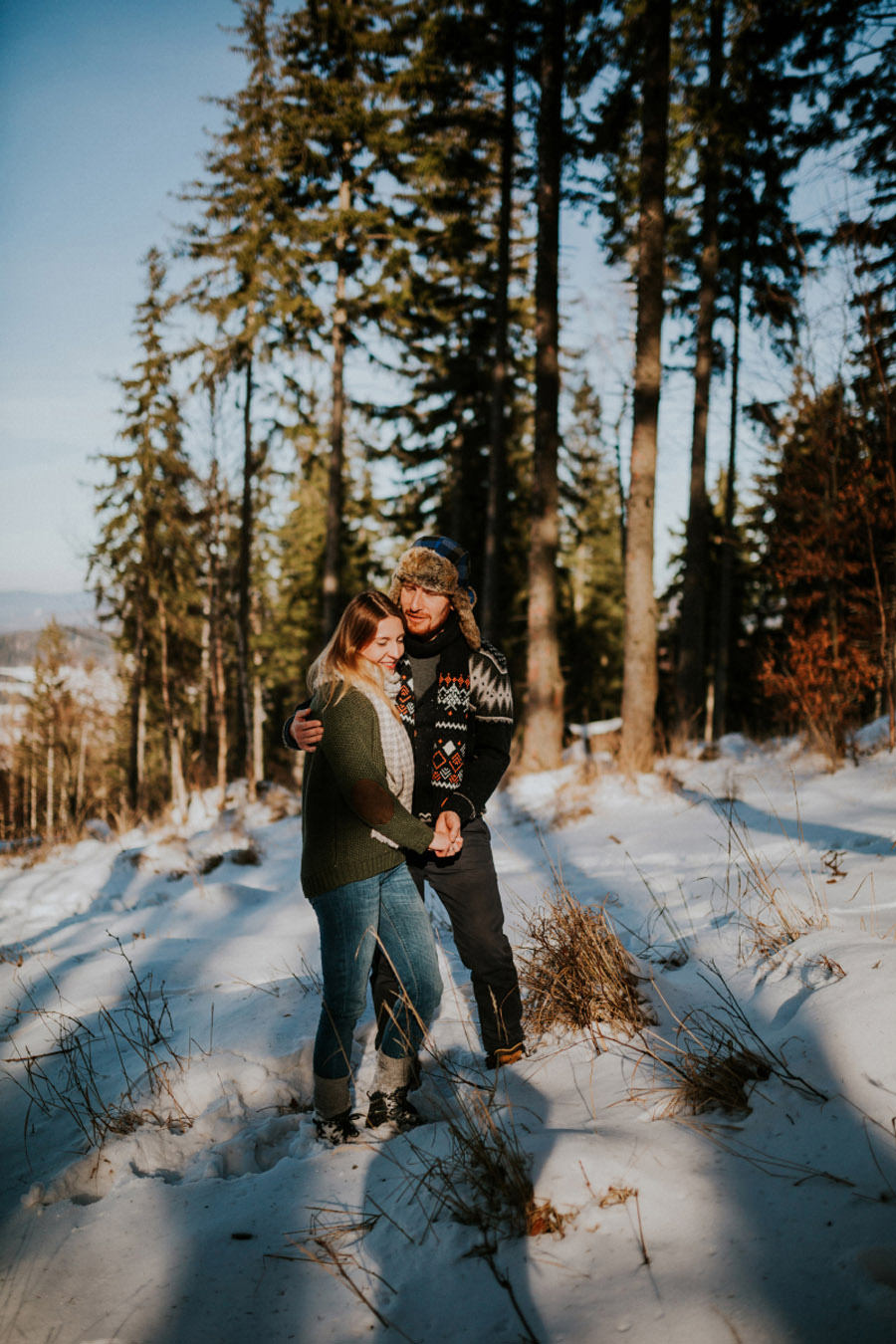 winter pine forest couple portrait