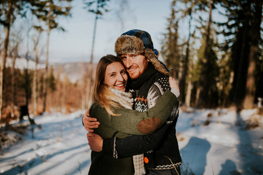 smiling couple in winter polish mountains