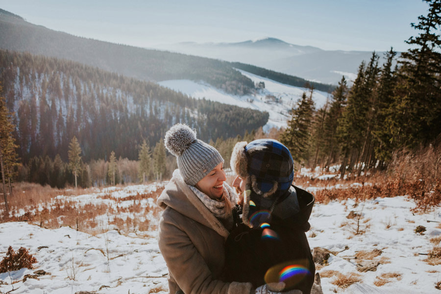 winter mountain sun couple portrait